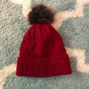 Red knit hat with faux fur lining